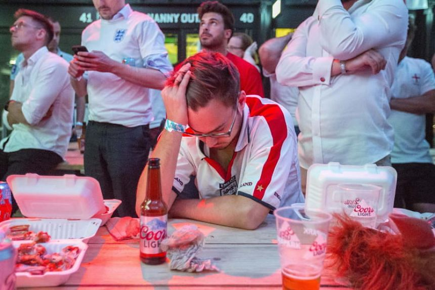 England fans react as they watch their team losing the 2018 World Cup semi-final between England and Croatia at in South London, Britain, on July 11, 2018.