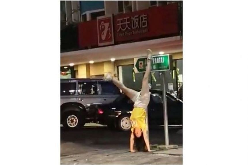 A video of a woman doing a handstand in the middle of the famous Gaya Street in downtown Kota Kinabalu has gone viral and attracted criticism.
