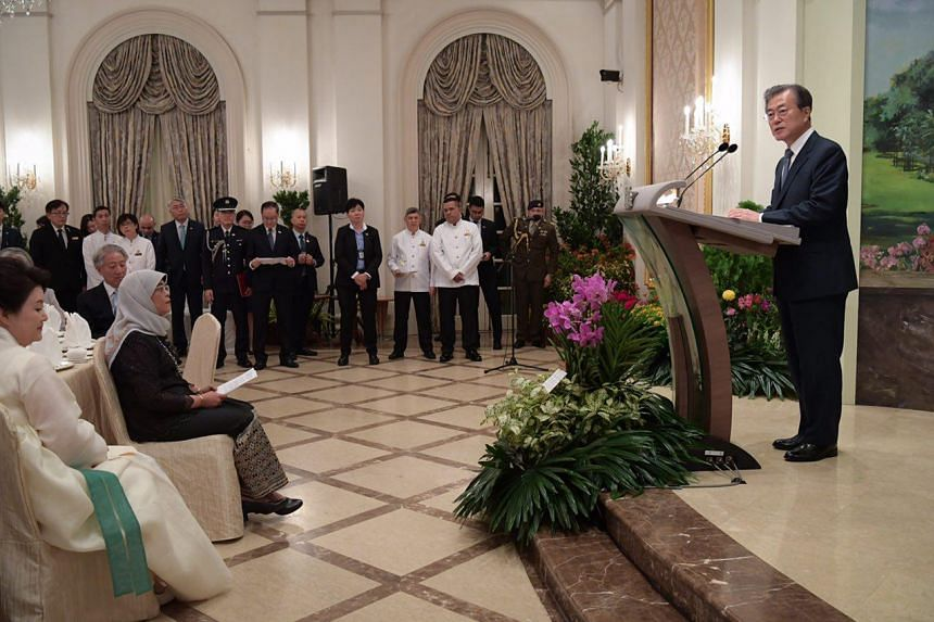 South Korean President Moon Jae-in delivers a speech during a state banquet hosted by President Halimah Yacob at the Istana on July 12, 2018.