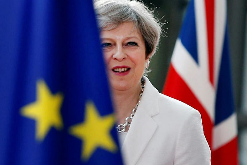 """British Prime Minister Theresa May published a 98-page """"white paper"""" setting out in detail the deep trading partnership Britain wants with the EU."""
