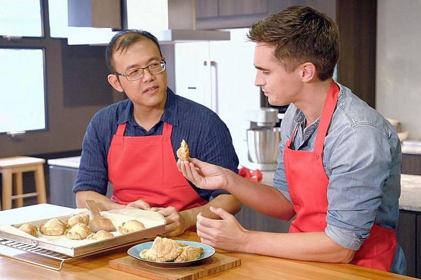 Donal Skehan and Singaporean cooking instructor Christopher Tan making curry puffs in Donal's Asian Baking Adventure.