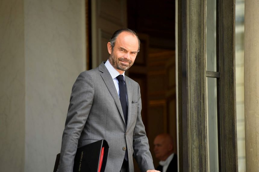 French Prime Minister Edouard Philippe leaves after a weekly cabinet meeting at the Elysee palace in Paris, on July 11, 2018.