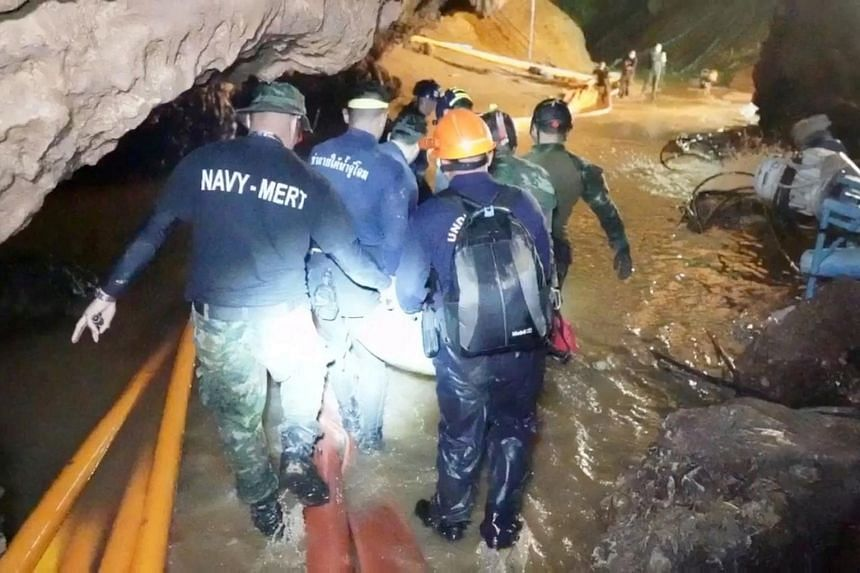 Rescue personnel working at the Tham Luang cave complex in the northern province of Chiang Rai, Thailand.
