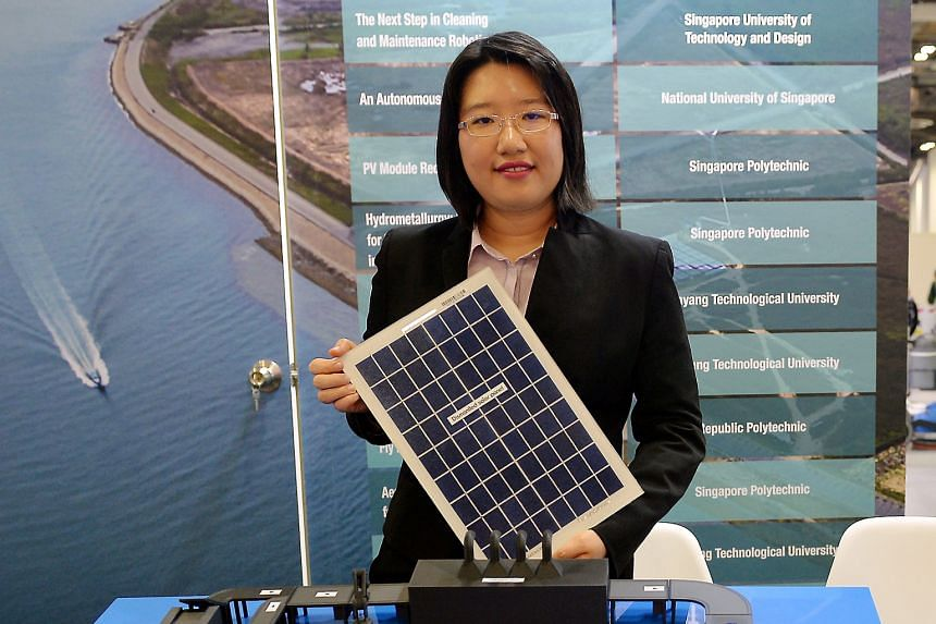 Dr Thong Ya Xuan with a model of a solar panel recycling plant. She says the Singapore Polytechnic team's method can recover almost all of a solar panel's materials.