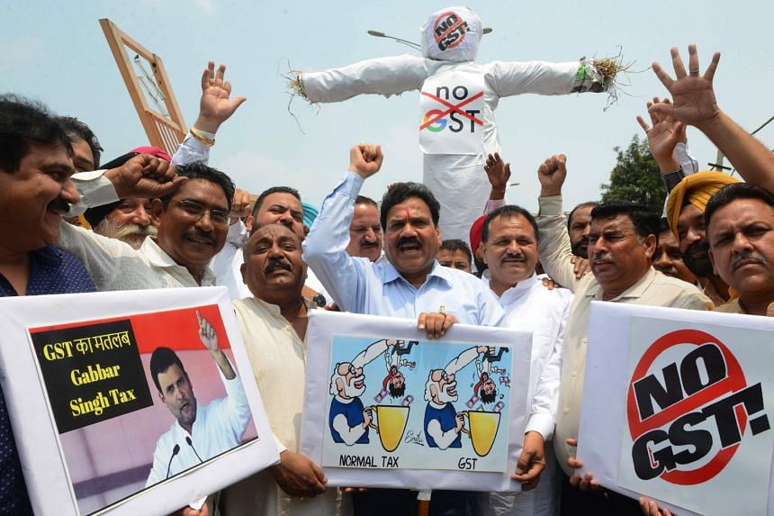 Congress Party members protesting against the goods and services tax in Amritsar on July 1, the first anniversary of the implementation of the tax.