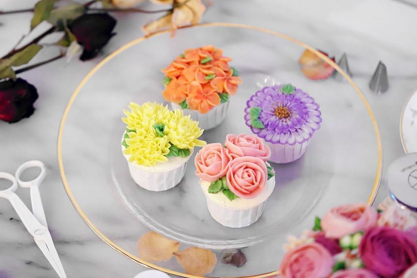 Learn to pipe flowers onto cupcakes at a workshop by Yume Patisserie.
