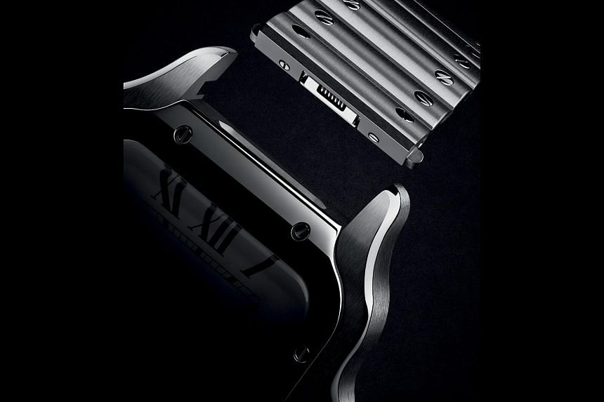 The new Santos de Cartier allows wearers to change the strap or adjust the bracelet without the need for tools.