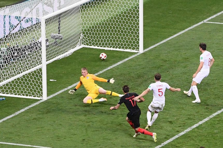 Croatia's forward Mario Mandzukic (centre) shoots and scores his team's second goal.