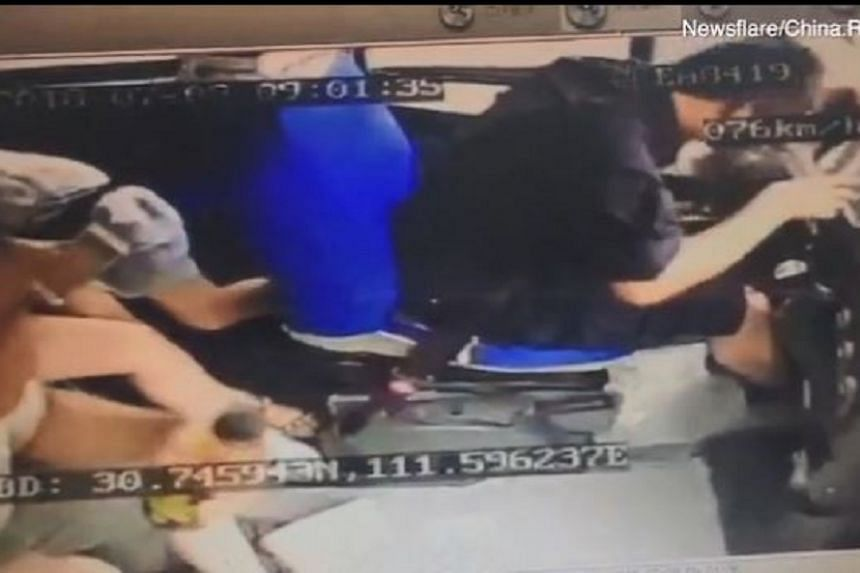 Bus driver Wang Fei suffered a mild concussion, as well as bruises to his arms and lips.