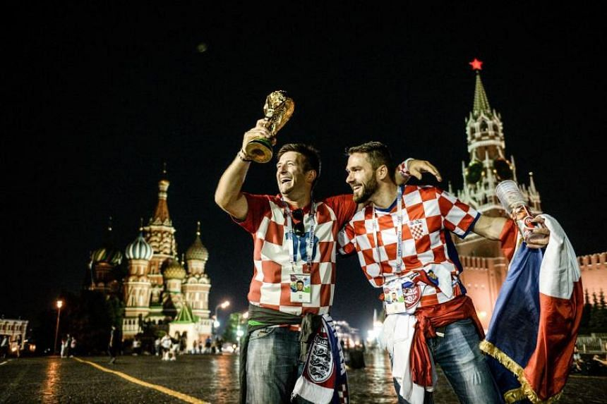 Croatia's supporters celebrate their team victory at Red Square in Moscow early on July 12, 2018.