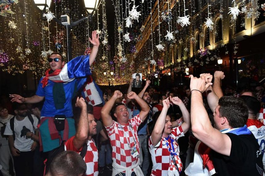 Croatia's supporters celebrate their win in the Russia 2018 World Cup semi-final football match between Croatia and England on Nikolskaya street in centrak in Moscow, on early July 12, 2018.