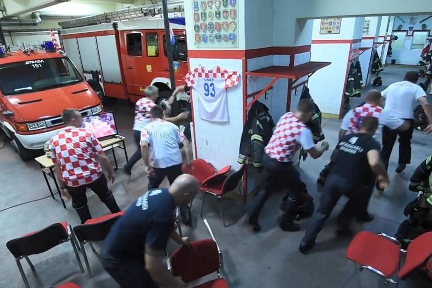 A video of the incident shows firemen, decked in Croatian jerseys, immediately rushing to put on their firemen suit after an announcement sounds over the department's broadcast.