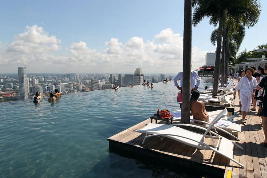 The Indian doctor molested the four women in the pool while on holiday in Singapore.