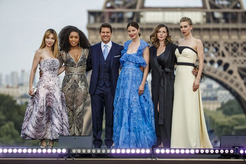 Cruise poses with cast members (from left) Alix Benezech, Angela Basset, Michelle Monaghan, Rebecca Ferguson and Vanessa Kirby in Paris.