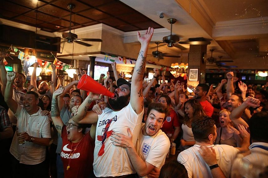 England fans celebrating at The Penny Black in Boat Quay after Gareth Southgate's team scored the opening goal of the World Cup semi-final against Croatia before conceding two goals.