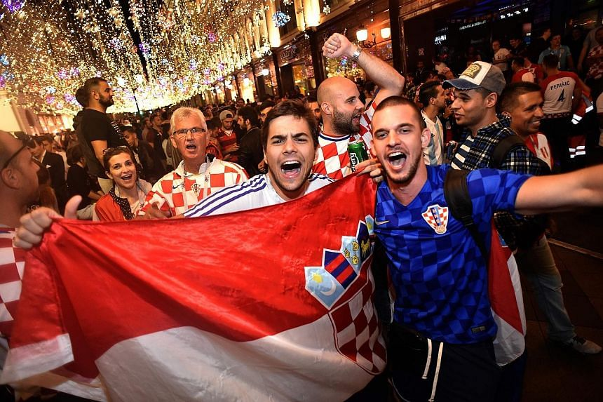 Croatian supporters celebrating early yesterday after their team's 2-1 win against England in the World Cup semi-final football match in Moscow on Wednesday night.