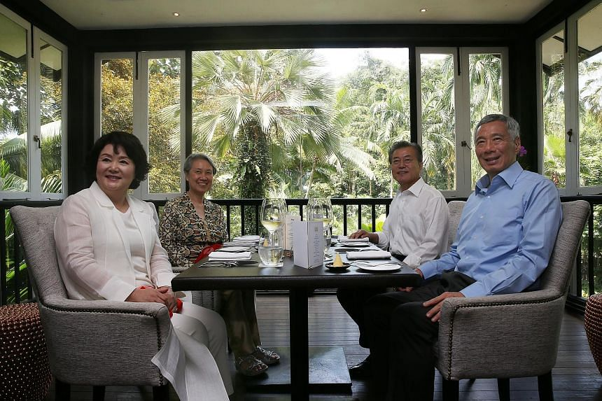 Prime Minister Lee Hsien Loong and Mrs Lee having lunch with South Korean President Moon Jae-in and his wife Kim Jung-sook at the Botanic Gardens yesterday. Mr Moon, who is here on a three-day state visit, said he and PM Lee agreed to expand bilatera