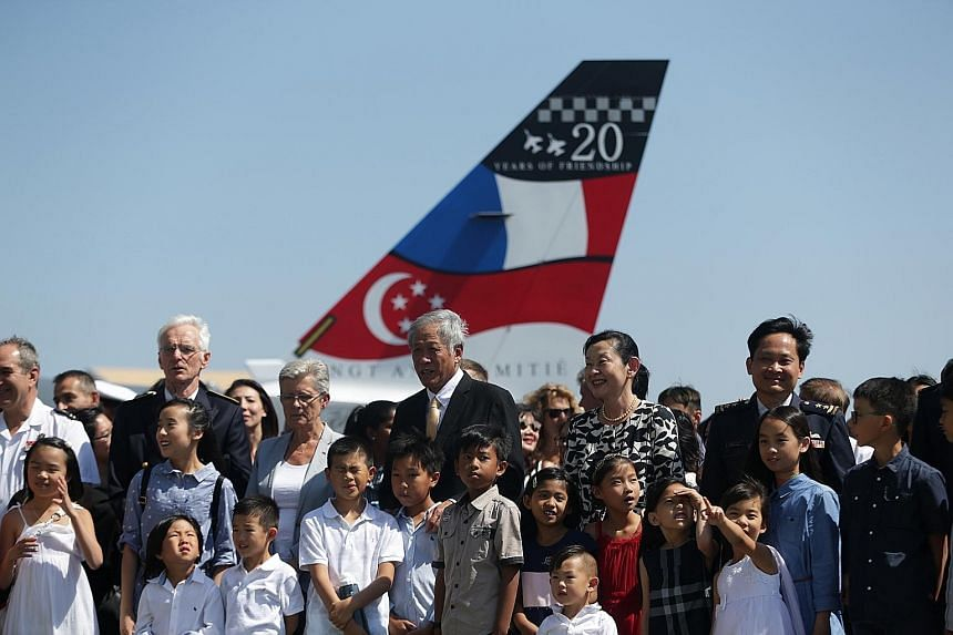 Defence Minister Ng Eng Hen and his wife with France's Secretary of State to the Minister for the Armed Forces Genevieve Darrieussecq (on Dr Ng's right) and Singapore's Chief of Air Force Mervyn Tan (right) with family members of 150 Squadron at Caza