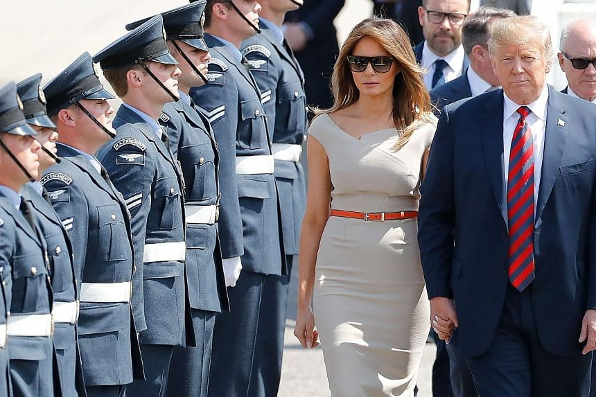 United States President Donald Trump and his wife, Melania, being greeted by an honour guard of Royal Air Force personnel after disembarking Air Force One at Stansted Airport. Many Britons were opposed to his visit, and police are expecting more than