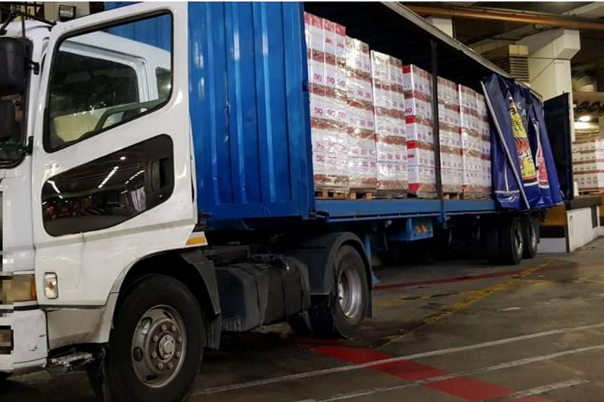 Officers seized 1,120 cartons of duty-unpaid cigarettes were seized from a Malaysia-registered lorry at Woodlands Checkpoint on Thursday (July 12).