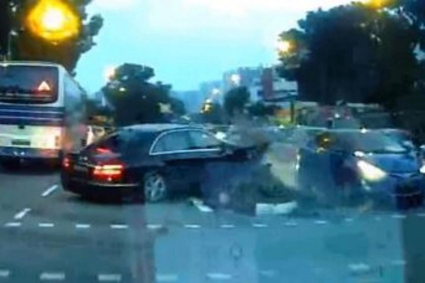 The first car is seen on video driving straight towards the centre island dividing the road, hitting the traffic light, which in turn falls and hits another car travelling in the opposite direction.