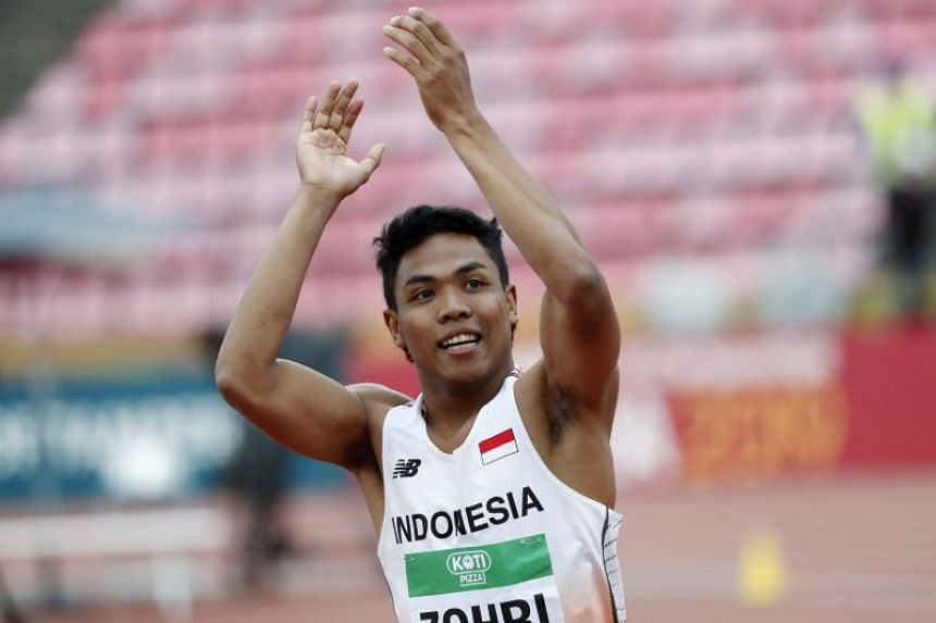 Lalu Muhammad Zohri of Indonesia celebrates his victory in men's 100m during the International Association of Athletics Federations World Junior Championships in Tampere, Finland, on July 11, 2018.