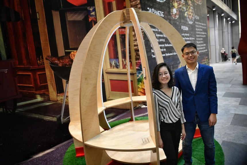"""Ms Shirley Lee, 27 and Mr Galven Lee, 29, with their """"Peace and Power"""" pavilion at Orchard Central mall on July 13, 2018."""