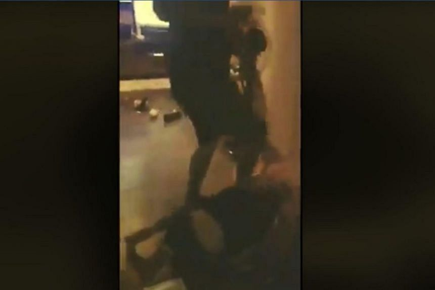 The couple was seen using a variety of items to repeatedly hit the men who were on the ground.