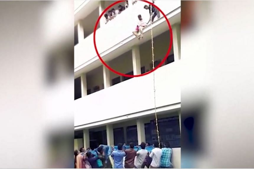 The student was pushed off from the ledge above the second floor by a drill instructor during a training exercise, causing her to crack her head in the fall.