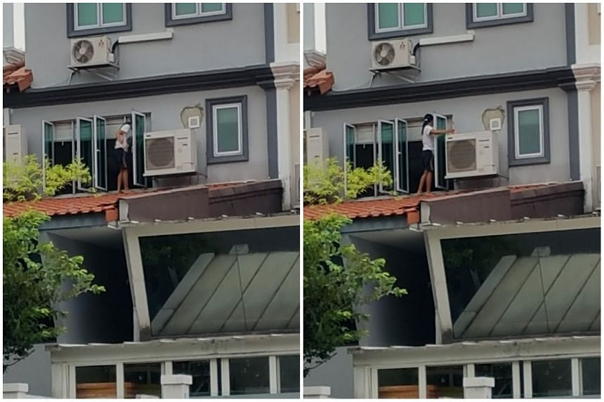 The maid appeared to be positioned precariously on the sloped roof, and was holding some cleaning equipment.