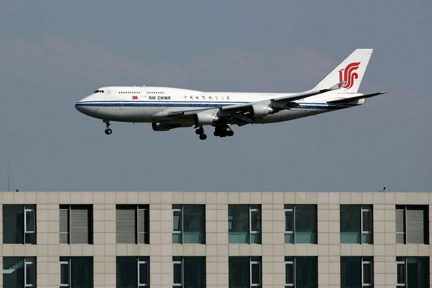 File photo of an Air China passenger jet landing at the Beijing Capital Airport.