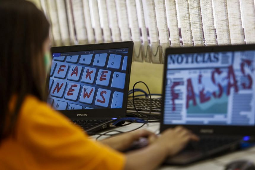 Students of Unified Educational Centers attend a lesson on 'Fake News: access, security and veracity of information', in Sao Paulo, Brazil, on June 21, 2018.