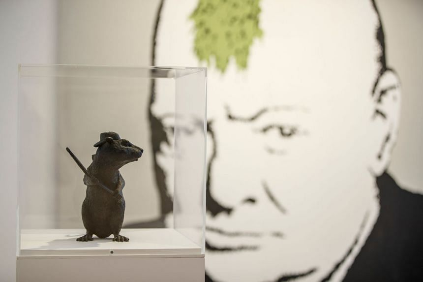 Banksy's 2006 artwork, Bronze Rat, on display at the Lazinc Gallery in London, on July 11, 2018.