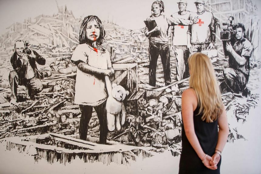Banksy's 2006 artwork, Media, on display at the Lazinc Gallery in London, on July 11, 2018.