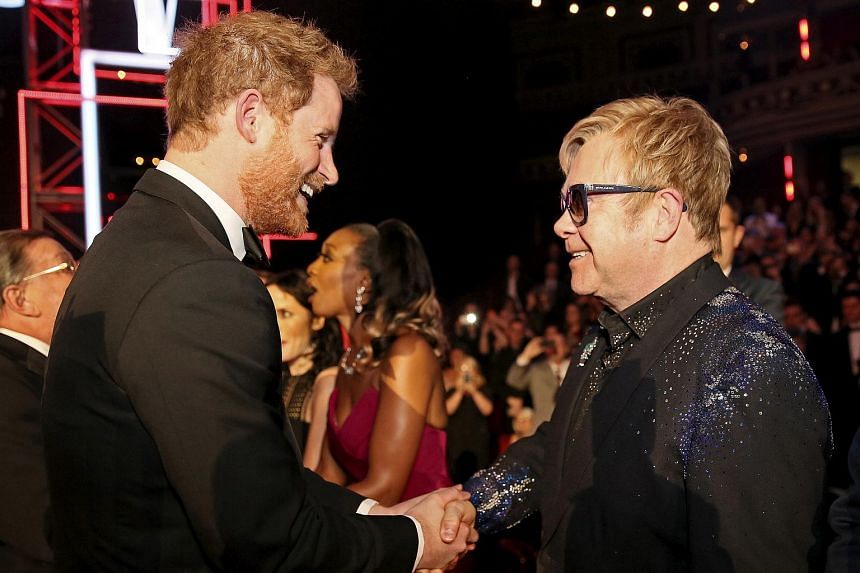 Britain's Prince Harry (left) and singer Elton John are both prominent HIV and Aids campaigners.