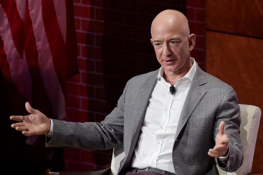 The first trips into space next year by Jeff Bezos' rocket company will cost about US$200,000 to US$300,000.