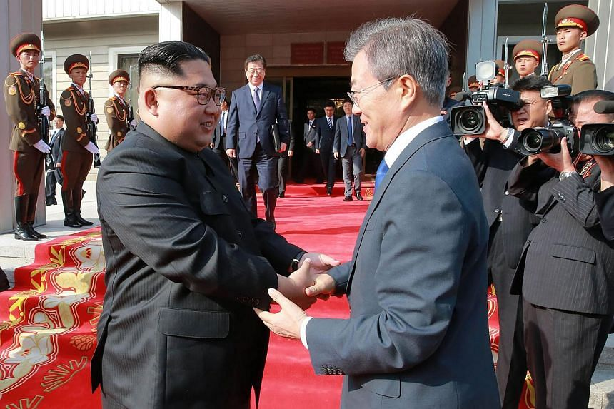 South Korea's President Moon Jae-in (right) shaking hands with North Korea's leader Kim Jong Un after their second summit at the north side of the truce village of Panmunjom, at the Demilitarized Zone.