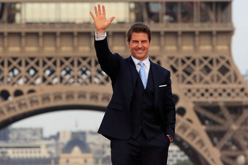 Tom Cruise posing in front the Eiffel Tower during the world premiere of Mission: Impossible - Fallout, on July 12, 2018.