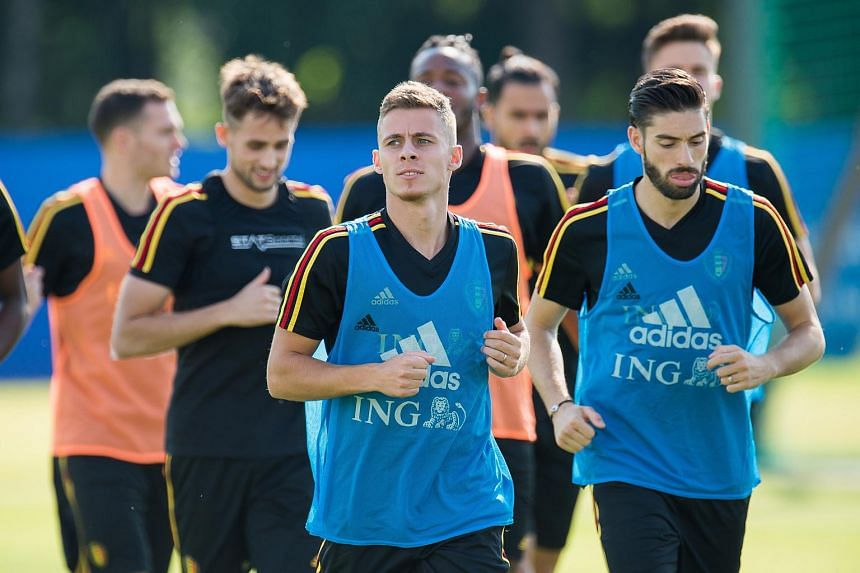Belgium's players Thorgan Hazard (centre) and Yannick Carrasco (right) attend a training session held at Guchkovo Stadium in Moscow, Russia, on July 12, 2018.