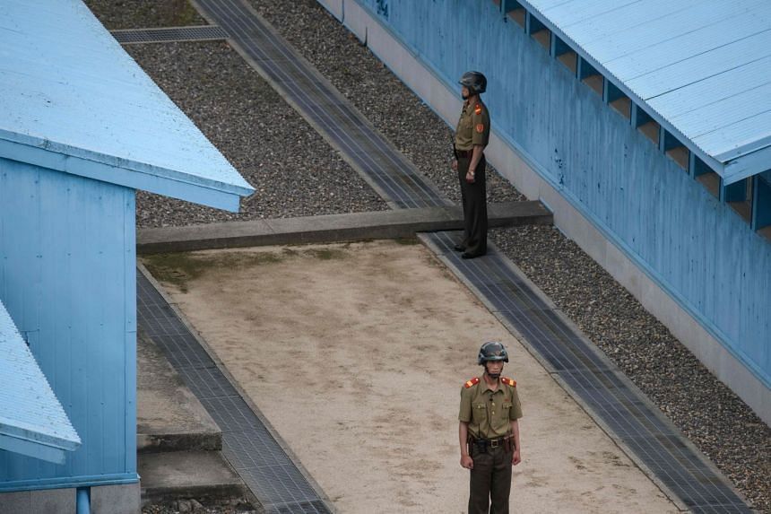 Korean People's Army soldiers on the North Korean side of the Demilitarised Zone in Panmunjom.