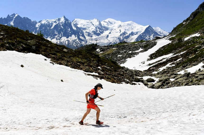 A participant competes in the Marathon of Mont-Blanc, on July 1, 2018, in Chamonix.
