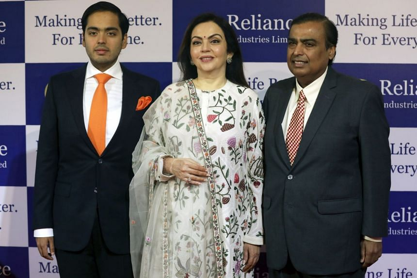 Mukesh Ambani (right), with his wife Nita and and son Anant.
