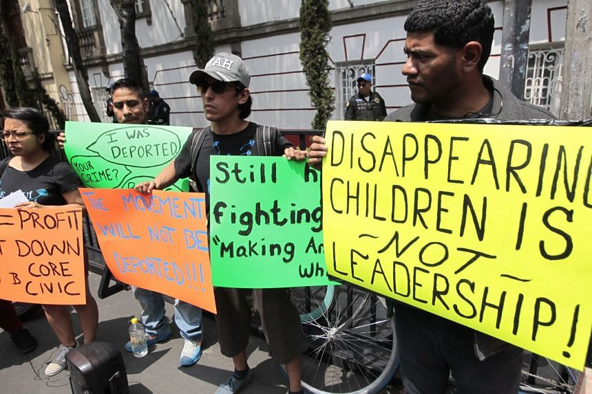 Protesters show signs to the motorcade transporting the US delegation visiting Mexico.