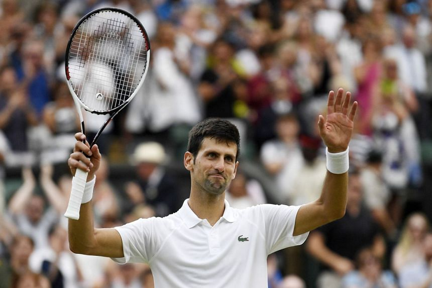 Djokovic reacts after beating Nadal.