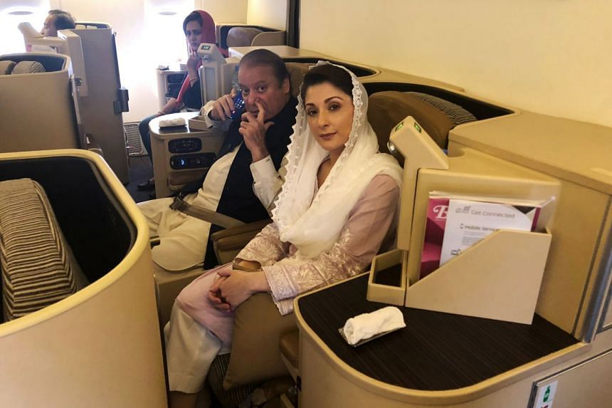 Sharif and daughter Maryam sit on a Lahore-bound flight due for departure, at Abu Dhabi International Airport.