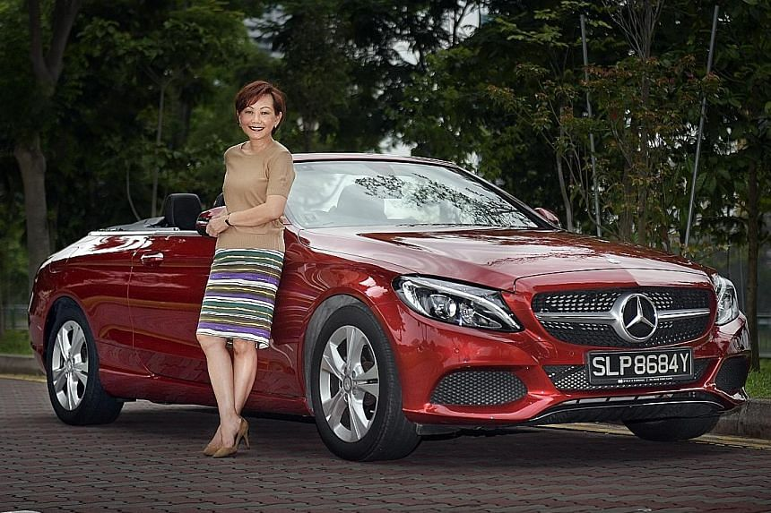Mrs Tammie Loke enjoys driving her cabriolet with the top down.