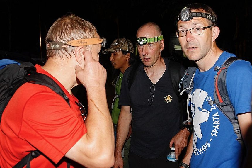British cave divers (from right) John Volanthen and Richard Stanton, who discovered the boys and their coach alive inside the cave.