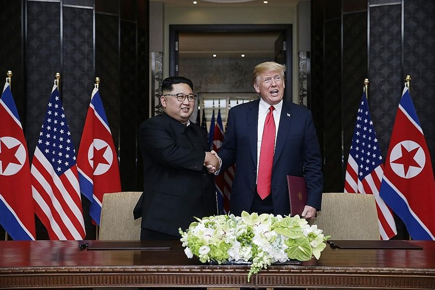 """US President Donald Trump and North Korean leader Kim Jong Un at the historic US-North Korea summit in Singapore on June 12. According to a letter released on Thursday, Mr Kim expressed hope for """"practical actions"""" in the future, but made no mention"""