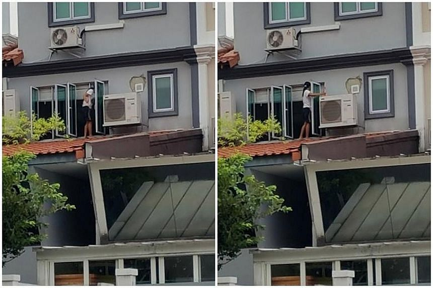 The woman, believed to be a maid, cleaning the windows of a Loyang Avenue home while standing on the roof at around 7.30pm on Monday.
