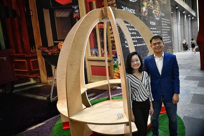 Ms Shirley Lee and Mr Galven Lee, co-founders of start-up StandCraft, with their winning design - the Peace and Power pavilion, which is equipped with wireless charging for phones and motion-sensor lighting.